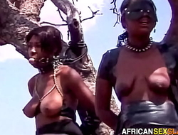 Ebony BDSM Sex Slaves Tied Up In Forest