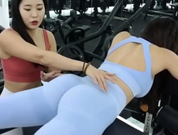 Two sexy Korean fitness models having fun working out