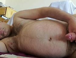 Nude Martin Lavallée mastubates and ejaculates