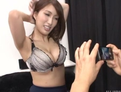 Busty Asian chick teases boyfriend with her racy melons