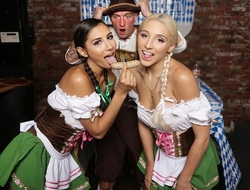 Two pigtailed hotties pleasuring bald-headed guy at Oktoberfest