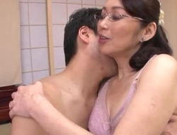 Japanese housewife with glasses gets fucked malarkey deep