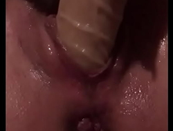 Bitch using dildo to squirt